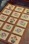 cream and brown embroidered block rug pattern